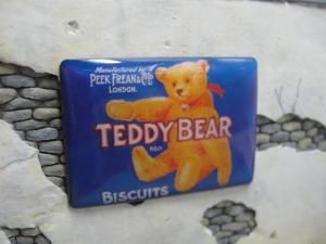"Reality in Scale Real Enamel Sign ""Teddy Bear Biscuits"" - 49x34mm"
